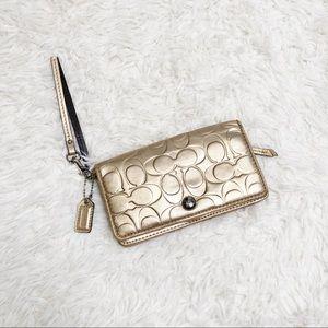 Gold metallic coach wallet wristlet signature